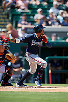 Atlanta Braves first baseman Johan Camargo (17) hits a double during a Grapefruit League Spring Training game against the Detroit Tigers on March 2, 2019 at Publix Field at Joker Marchant Stadium in Lakeland, Florida.  Tigers defeated the Braves 7-4.  (Mike Janes/Four Seam Images)