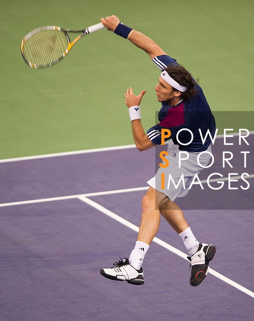 SHANGHAI, CHINA - OCTOBER 15:  Juan Monaco of Argentina returns a ball to Jurgen Melzer of Austria during day five of the 2010 Shanghai Rolex Masters at the Shanghai Qi Zhong Tennis Center on October 15, 2010 in Shanghai, China.  (Photo by Victor Fraile/The Power of Sport Images) *** Local Caption *** Juan Monaco