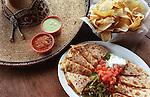 CONTACT FILED:  EL TIEMPO-HOUSTON.1/31/02--Shrimp and bacon quesadillas are featured at El Tiempo Mexican restaurant at 8135 I-10 West.    HOUCHRON CAPTION  (02/24/2002):  El Tiempo's quesadillas.