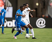 DENVER, CO - JUNE 19: Samuel Camille #18 attacks and is defended by Maykel Reyes #9 during a game between Martinique and Cuba at Broncos Stadium on June 19, 2019 in Denver, Colorado.