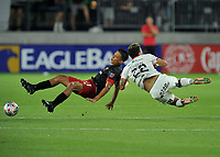 WASHINGTON, DC - JULY 7: Yamil Asad #11 of D.C. United battles for the ball with Barlon Sequeira #22 of Liga Deportiva Alajuense during a game between Liga Deportiva Alajuense  and D.C. United at Audi Field on July 7, 2021 in Washington, DC.