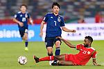 Shibasaki Gaku of Japan (L) is tackled by Harib Al Saadi of Oman (R) during the AFC Asian Cup UAE 2019 Group F match between Oman (OMA) and Japan (JPN) at Zayed Sports City Stadium on 13 January 2019 in Abu Dhabi, United Arab Emirates. Photo by Marcio Rodrigo Machado / Power Sport Images