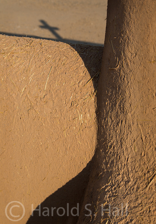 Long afternoon Shadows are cast at the San Francisco de Asis church in Ranchos de Taos in New Mexico.