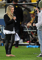 Sky's The Cricket Show presenter Laura McGoldrick presents in bare feet after having to remove her heels during the HRV Cup Twenty20 cricket match between Wellington Firebirds and Canterbury Wizards at Westpac Stadium, Wellington, New Zealand on Friday, 9 November 2012. Photo: Dave Lintott / lintottphoto.co.nz