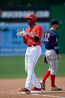 Batavia Muckdogs Jerar Encarnacion (27) celebrates after hitting a triple during a game against the Lowell Spinners on July 15, 2018 at Dwyer Stadium in Batavia, New York.  Third baseman Korby Batesole (12) is also shown.  Lowell defeated Batavia 6-2.  (Mike Janes/Four Seam Images)