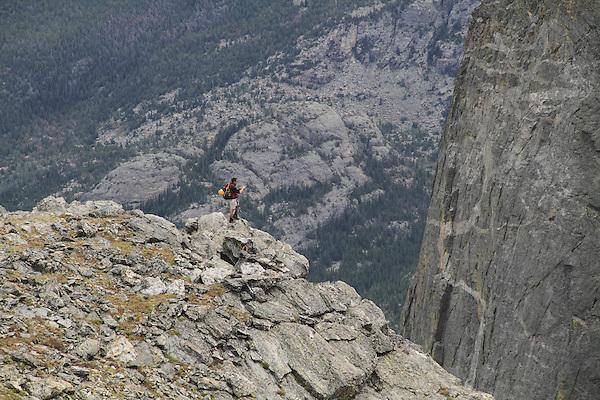 Caucasian mountain climber hiking the Flattop Mountain Trail in Rocky Mountain National Park, west of Estes Park, Colorado, USA