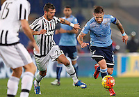 Calcio, Serie A: Lazio vs Juventus. Roma, stadio Olimpico, 4 dicembre 2015.<br /> Lazio's Lucas Biglia, right, is chased by Juventus' Stefano Sturaro during the Italian Serie A football match between Lazio and Juventus at Rome's Olympic stadium, 4 December 2015.<br /> UPDATE IMAGES PRESS/Riccardo De Luca
