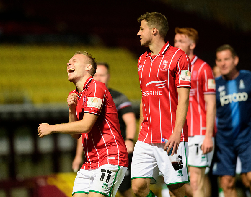 Lincoln City's Anthony Scully, left, and James Jones leave the pitch at the end of the game<br /> <br /> Photographer Chris Vaughan/CameraSport<br /> <br /> Carabao Cup Second Round Northern Section - Bradford City v Lincoln City - Tuesday 15th September 2020 - Valley Parade - Bradford<br />  <br /> World Copyright © 2020 CameraSport. All rights reserved. 43 Linden Ave. Countesthorpe. Leicester. England. LE8 5PG - Tel: +44 (0) 116 277 4147 - admin@camerasport.com - www.camerasport.com