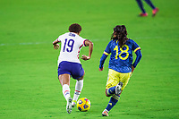 ORLANDO, FL - JANUARY 18: Crystal Dunn #19 of the USWNT dribbles the ball during a game between Colombia and USWNT at Exploria Stadium on January 18, 2021 in Orlando, Florida.
