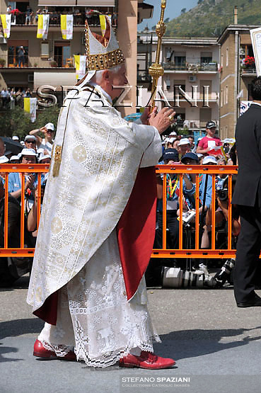 Pope Benedict XVI delivers his blessing during an open-air Mass in Cassino, central Italy, Sunday, May 24, 2009.