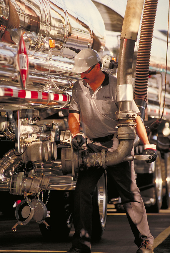 Worker loading fuel truck