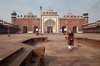 Agra, India.  Jama Masjid (Friday Mosque), built 1648.  Chhatris (domed pavilions) line the roof.  The minaret to the right of the main entrance collapsed in 1970.