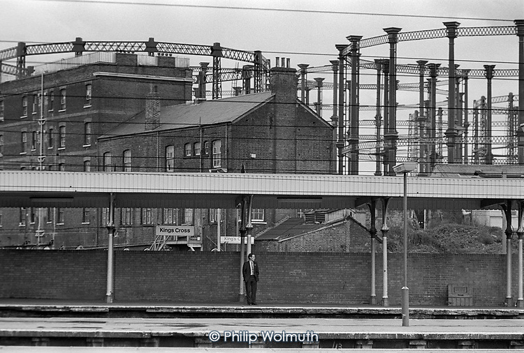 Passenger on a platform at Kings Cross station, London.