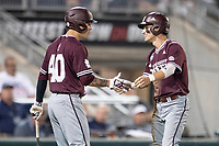 Mississippi State Bulldogs outfielder Jake Mangum (15) celebrates with teammate Elijah MacNamee (40) during Game 10 of the NCAA College World Series against the Louisville Cardinals on June 20, 2019 at TD Ameritrade Park in Omaha, Nebraska. Louisville defeated Mississippi State 4-3. (Andrew Woolley/Four Seam Images)