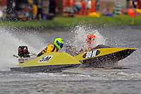 The bottom falls out of 50-M as 5-M races past.  (Outboard Runabouts)