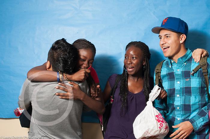 Education High School group of students in corridor, friends hugging