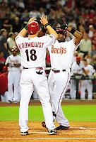 Apr. 12, 2011; Phoenix, AZ, USA; Arizona Diamondbacks outfielder Justin Upton (right) is congratulated by teammate Willie Bloomquist after hitting a three run home run in the second inning against the St. Louis Cardinals at Chase Field. Mandatory Credit: Mark J. Rebilas-