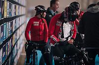 1 of the Lotto-Soudal ladies getting an old-school wind layer stuffed in (against the freezing temperatures outside) at the pre-race team presentation<br /> <br /> Omloop Het Nieuwsblad 2018<br /> Gent › Meerbeke: 122km (BELGIUM)