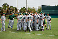 Dartmouth Big Green team huddle before a game against the USF Bulls on March 17, 2019 at USF Baseball Stadium in Tampa, Florida.  USF defeated Dartmouth 4-1.  (Mike Janes/Four Seam Images)