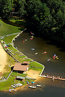 Kayaking in the lake at Camp Raven Knob Scout Reservation, one of the largest Boy Scout camps in the United States. Camp Raven Knob is located within Boy Scouts of America's Old Hickory Council in Mt. Airy, North Carolina. Troops from across the US attend the camp's one-week residential boys' summer programs, which offer instruction on more than 40 merit badges, adventure programs and new Scout orientation.