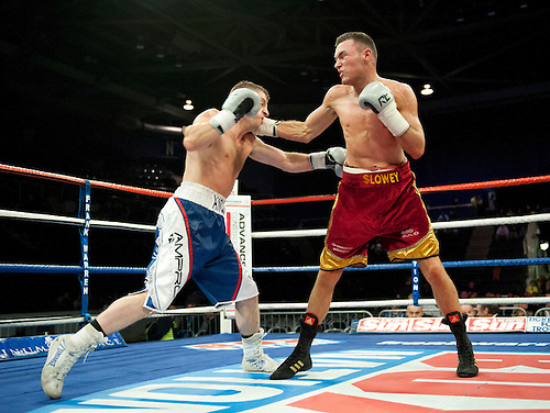 GLASGOW, SCOTLAND - MARCH 10: Jonathan Slowey (red and gold shorts) exchanges blows with James Ancliffe (blue and white shorts) during a Super-Bantamweight contest on the Ricky Burns undercard at the Braehead Arena on March 10, 2012 in Glasgow, Scotland. (Photo by Rob Casey/Getty Images)