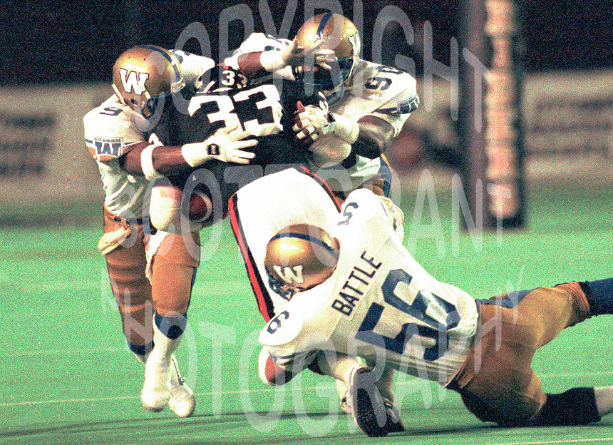 Ken Pettway  Fred Robinson Greg Battle Winnipeg Blue Bombers 1987. Photo F. Scott Grant