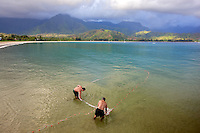 Native hawaians net fishing for mackerel. Hanalei Bay. Kauai, Hawaii.