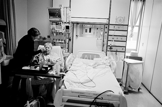 Chicago, Illinois<br /> USA<br /> December 18, 2009<br /> <br /> At the University of Chicago Medical Center Geraldine Martin, 80 years old, in the intensive care unit just more then 12 hours after open heart surgery to have a valve replaced and hole repaired. She is accompanied by her sister Helen Martin who helps to feed her.