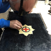 BNPS.co.uk (01202 558833)<br /> Pic: MarkBroadbent/BNPS<br /> <br /> Resoring the crests on the leather coating of the carriage.<br /> <br /> Last Post - Britain's last Royal Mail carriage, that bizarrely once survived an attack by a lion outside Salisbury, has been saved for the nation.<br /> <br /> The 200-year-old horse-drawn carriage harks back to the golden age of the Royal Mail when crowds gathered along the route to see the lightning-quick service thunder by.<br /> <br /> The restored four horse coach was known as 'Quicksilver' as it was the fastest in the land on its regular 21 hour run from Devonport, Devon, to London.<br /> <br /> But the red and black wooden wagon went down in history for an extraordinary incident involving a lion in the English countryside in 1816.