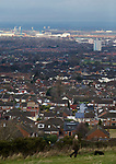 A dog walker takes in the view of Teesside from Ormesby Bank.  16th January 2021, Middlesbrough 0 Birmingham 1.