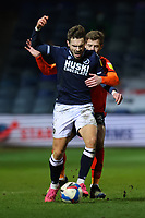 23rd February 2021; Kenilworth Road, Luton, Bedfordshire, England; English Football League Championship Football, Luton Town versus Millwall; Martin Cranie of Luton Town fouls Tom Bradshaw of Millwall