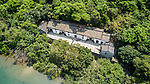 Sheung Yiu Village and surrounds viewed from  a drone.  This is a fortified Hakka village built on raised ground in around 1850.  Consists of a row of eight houses and is entered via  gated watch tower.  The village prospered briefly due to its lime kiln.  Since restoration in 1983, it has operated as a folk museum.
