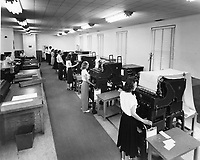 """Women and men working in the tabulating department in Administrative Annex building.<br /> Date: 1953<br /> Stamped verso """"Credit Photo CF&I Blast Pueblo, Colo.""""<br /> Numbered CFI_ADM_0032<br /> Prints Admin Pueblo Box 8"""