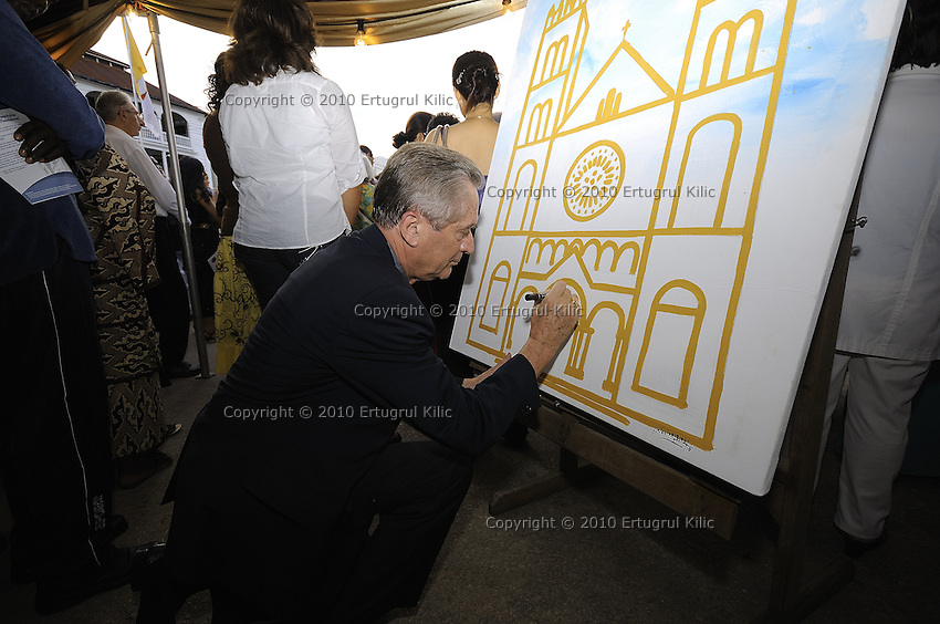 Bishop of Rotterdam Monseigneur Drs. A.H. van Luyn s.d.b. puts his signature as first one to sign board prepared for the opening.....Official Opening Ceremony of ST. Petrus and Paulus Cathedral (AKA World's largest wooden cathedral)