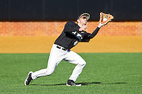 Grant Shambley (43) of the Wake Forest Demon Deacons catches a fly ball in left field during the game against the Youngstown State Penguins at Wake Forest Baseball Park on February 24, 2013 in Winston-Salem, North Carolina.  The Demon Deacons defeated the Penguins 6-5.  (Brian Westerholt/Four Seam Images)