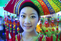 China. Shanghai. World Expo. Expo 2010 Shanghai China.  China Pavilion. A young woman wears the traditional clothes and hat inside the Guanqxi pavilion. 25.06.10 © 2010 Didier Ruef