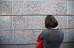 A visitor looks at the Wall of the Dead in the Always Lost: A Meditation on War exhibit at the Legislative Building in Carson City, Nev., on Monday, April 6, 2015. <br />