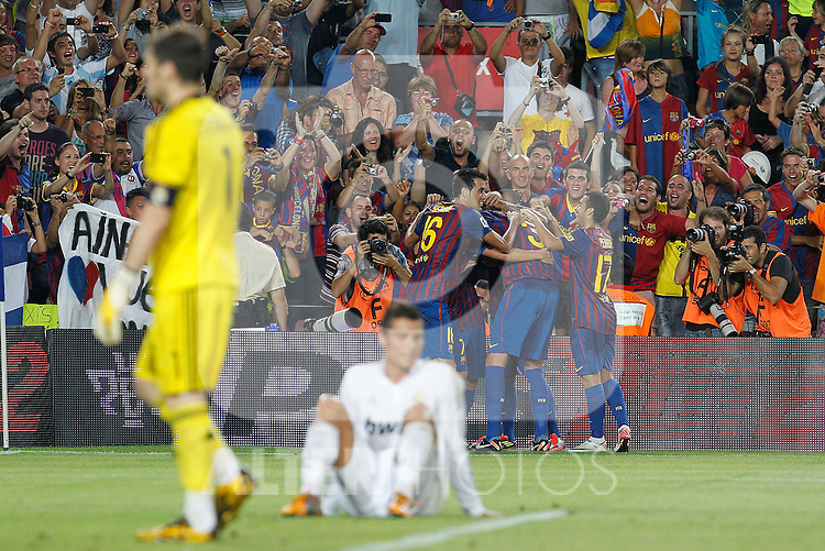 FC Barcelona's players celebrates goal in presence of Real Madrid's Cristiano Ronaldo (c) and Iker Casillas dejected during Spanish Supercup 2nd match.August 17,2011. (ALTERPHOTOS/Acero)