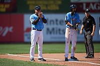 Erie SeaWolves coach Mike Rabelo (58), base runner Cole Peterson, and umpire Matt Carlyon during an Eastern League game against the Akron RubberDucks on June 2, 2019 at UPMC Park in Erie, Pennsylvania.  Erie defeated Akron 8-5 in eleven innings in the second game of a doubleheader.  (Mike Janes/Four Seam Images)