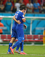 Theofanis Gekas of Greece is consoled by a team mate after missing his penalty in the shootout