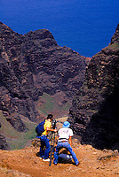 Film-maker Paul Atkins above Nualola Aina Valley, Na Pali Coast, during filming of Nat. Geo. Special Strangers in Paradise.