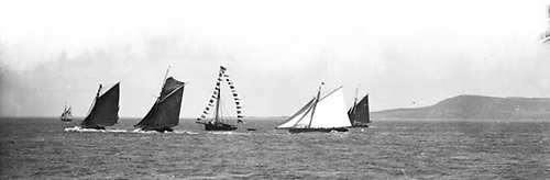 The tan-sailed fishing boats of Ringsend are racing for the Dublin market as they slice through the finish line of an RIYC Regatta on Dublin Bay