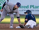 Reno Aces Tony Campana slides safely into second as Tucson Padres second baseman Dean Anna makes the tag during their game played on Monday, May 24, 2013 in Reno, Nevada.