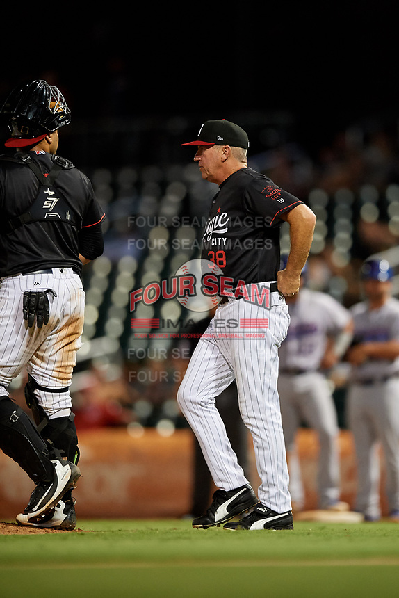 Birmingham Barons pitching coach Richard Dotson (38) walks to the mound during a game against the Tennessee Smokies on August 16, 2018 at Regions FIeld in Birmingham, Alabama.  Tennessee defeated Birmingham 11-1.  (Mike Janes/Four Seam Images)