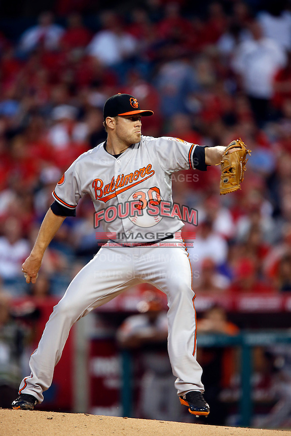 Chris Tillman #30 of the Baltimore Orioles pitches against the Los Angeles Angels at Angel Stadium on May 2, 2013 in Anaheim, California. Baltimore defeated Los Angeles 5-1. (Larry Goren/Four Seam Images)