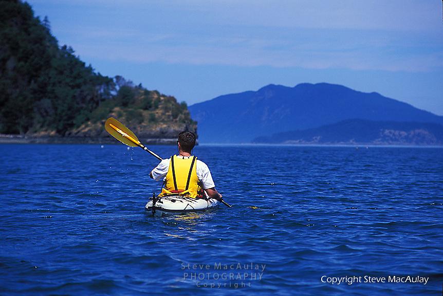 Sea kayaking in the San Juan Islands Archipelago, Puget Sound, WA.