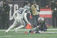 FOXBOROUGH, MA - NOVEMBER 24: New England Patriots Cornerback Stephon Gilmore #24 intercepts a pass intended for Dallas Cowboys Wide Receiver Amari Cooper #19 during a game between Dallas Cowboys and New England Patriots at Gillettes on November 24, 2019 in Foxborough, Massachusetts.