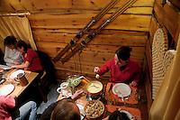 Diners eat fondue savoyarde at the restaurant l'Auberge d'Oul, Bonneval sur Arc, Savoie, France, 16 February 2012