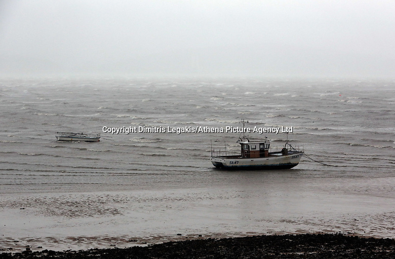 WEATHER PICTURE WALES<br /> Pictured: A boat in the receding tide in Mumbles, near Swansea, south Wales. Friday 14 February 2014<br /> Re: More strong winds have been forecast and severe flood warning issued for parts of the UK.