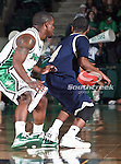 North Texas Mean Green guard Josh White (10) defends Florida International University Panthers guard Phil Gary (4) in the NCAA  basketball game between the Florida International University Panthers and the University of North Texas Mean Green at the North Texas Coliseum,the Super Pit, in Denton, Texas. UNT defeated FIU 87 to 77